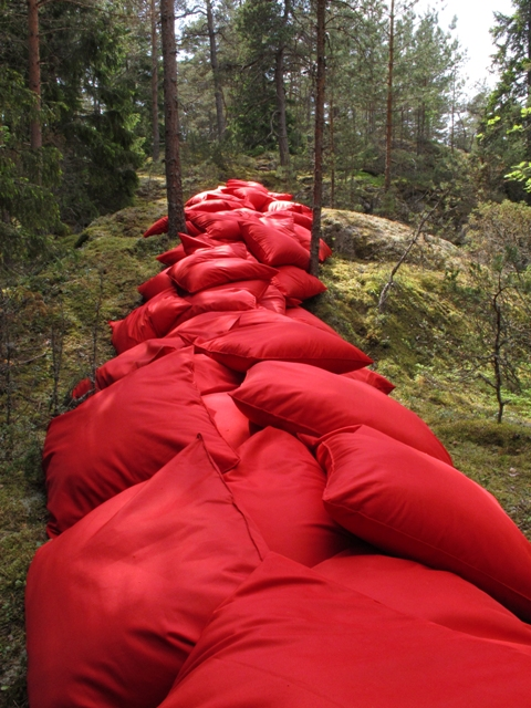 Jetty 2016, 106 red pillows, waterproof fabric, sawdust. 18m x 4m x 2m,  BAREFOOT PATH, Korpo/Korppoo, Finland